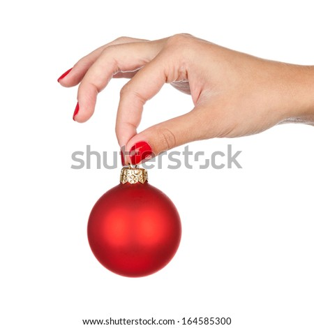 Woman holding christmas red ball, close-up of hand isolated on white.