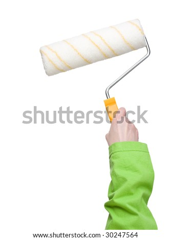 Woman holding clean paint roller in one hand