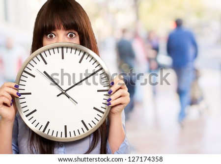 Woman Holding Clock, Outdoor - stock photo