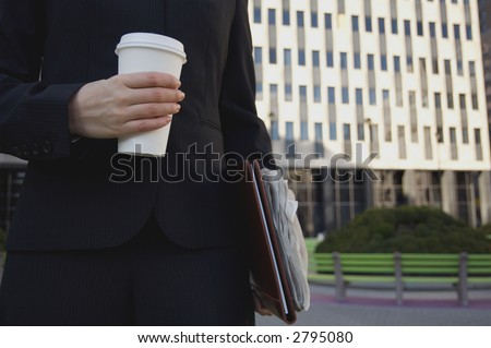 Woman holding coffee cup - stock photo