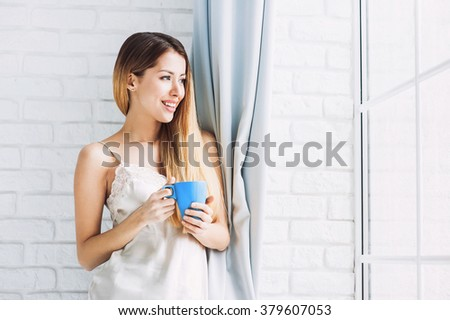 Woman holding coffee cup in the morning
