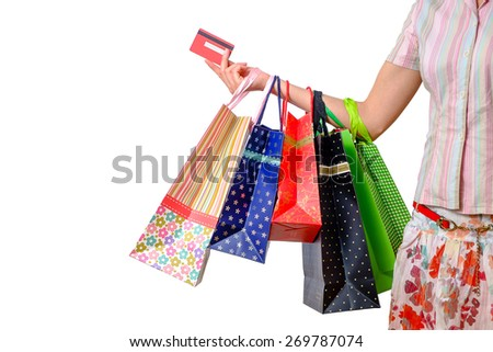 Woman holding colorful shopping bags and credit card isolated on white   - stock photo