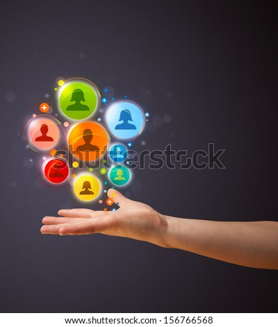 Woman holding colorful social network icons in her hand