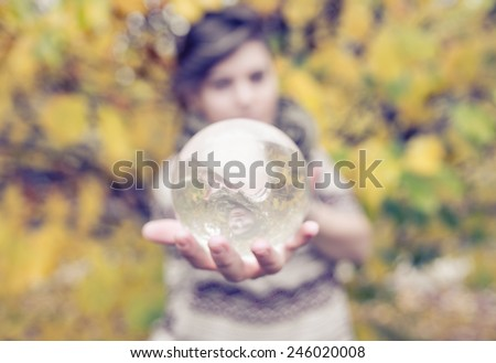 woman holding contact juggling glass sphere - stock photo
