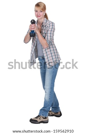 Woman holding cordless drill - stock photo