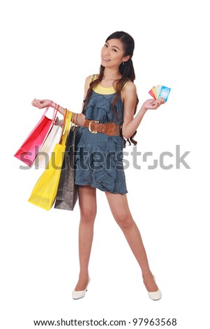 woman holding credit card and shopping bags - stock photo