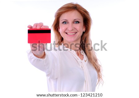 woman holding credit card in hand - stock photo