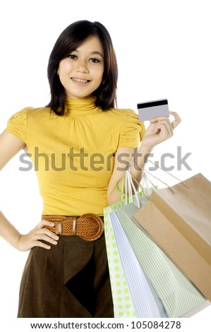 Woman holding credit card ready for shopping. Isolated over white background - stock photo