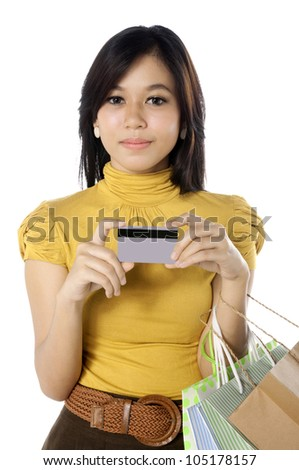 Woman holding credit card ready for shopping. Isolated over white background