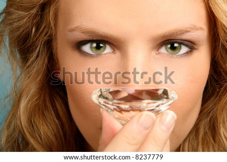 Woman Holding Diamond With High Depth of Field