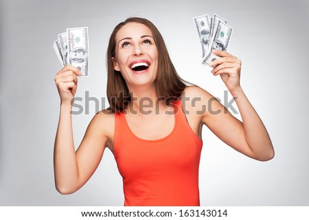 Woman holding dollar bills  - stock photo