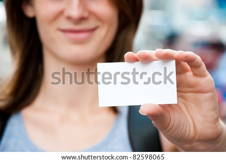 woman holding empty white card - stock photo