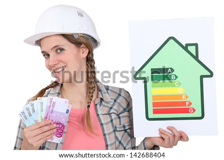 Woman holding energy score card - stock photo