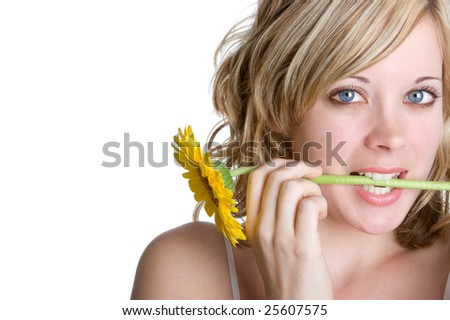 Woman Holding Flower in Mouth - stock photo
