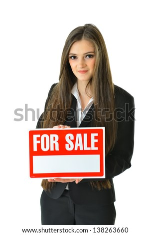"Woman Holding ""For Sale"" Sign (vertical 3/4 view) - stock photo"
