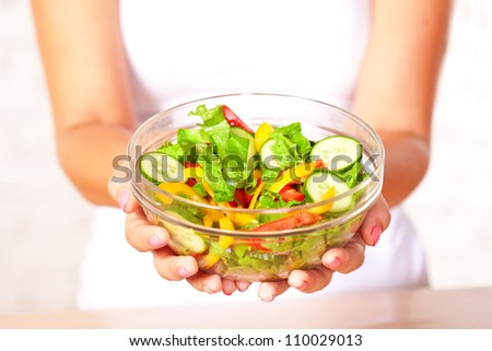 woman holding  fresh  salad in glass boil