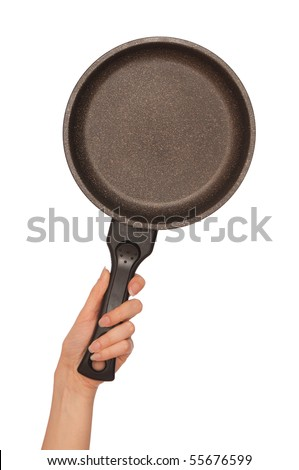woman holding frying pan for cooking in the hand - stock photo