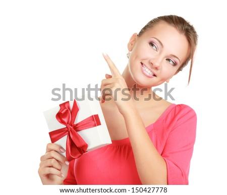 Woman holding gift box isolated on white background - stock photo