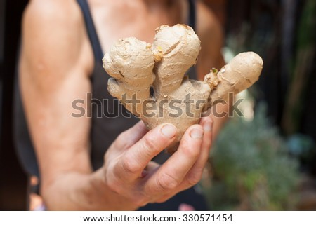 woman holding ginger