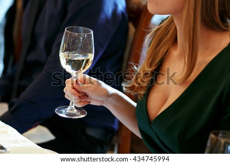woman holding  glass of champagne and toasting, happy festive moment, luxury celebration concept