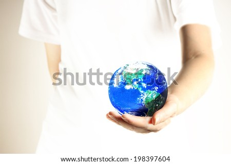 Woman holding globe on her hand, . Elements of this image furnished by NASA