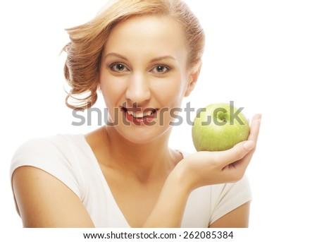 Woman holding green apple. Studio shot. - stock photo