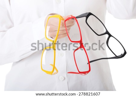 Woman holding group of eyeglasses.
