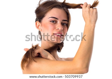 Woman holding hair around her face