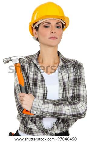 Woman holding hammer - stock photo