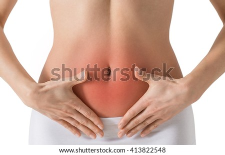 Woman holding hands on a belly. Stomach-ache concept. Isolated on white.