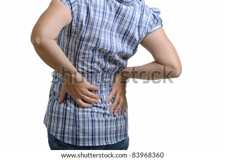 woman holding hands to his aching back - stock photo