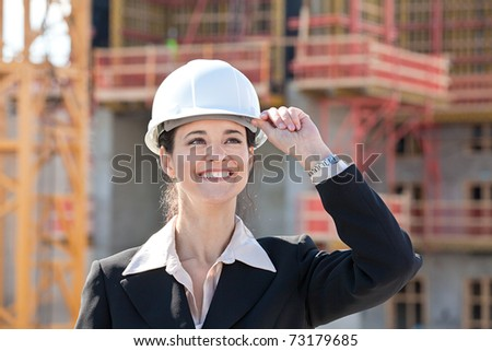 Woman holding hard hat