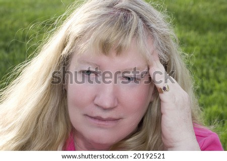 Woman holding head because of stressful headache