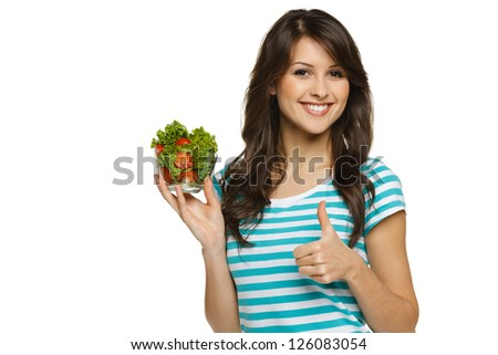 Woman holding healthy salad meal and showing thumb up sign, over white