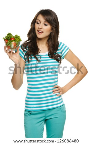 Woman holding healthy salad meal, over white - stock photo