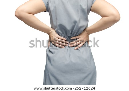 woman holding her back with pain on white back - stock photo