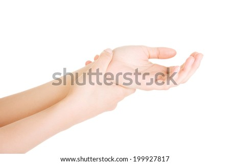 Woman holding her hand - pain concept . Isolated on white
