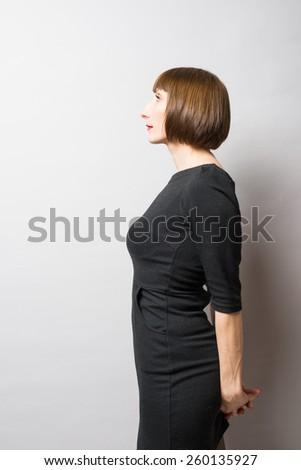 woman holding her hands behind her back