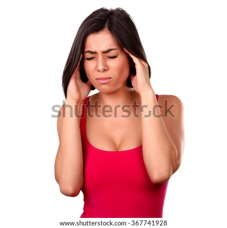 Woman holding her temples in pain on white background