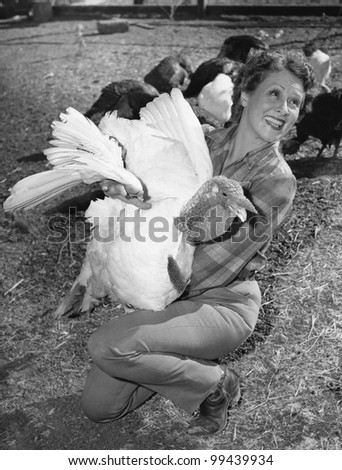 Woman holding live turkey - stock photo