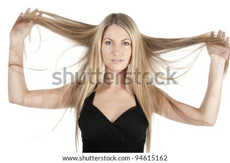 Woman holding long hair on white background - stock photo