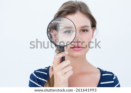 Woman holding magnifying glass on white background