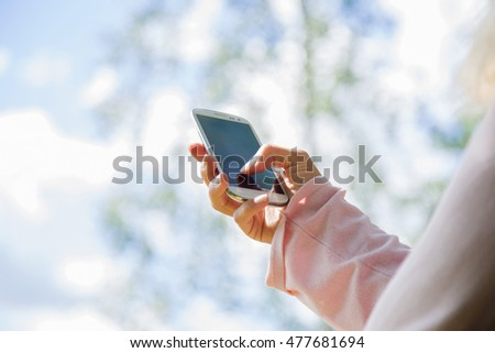Woman holding mobile phone.