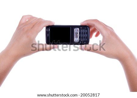 woman holding mobile phone isolated on white background. landscape orientation.