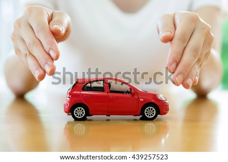 woman holding model of car in his hands, closeup