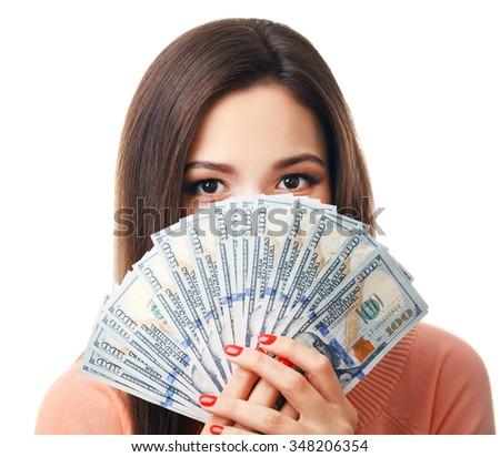 Woman holding money isolated on white, closeup - stock photo