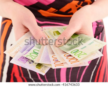 Woman holding new Swedish bank notes, NOTE: the new 2015 model.