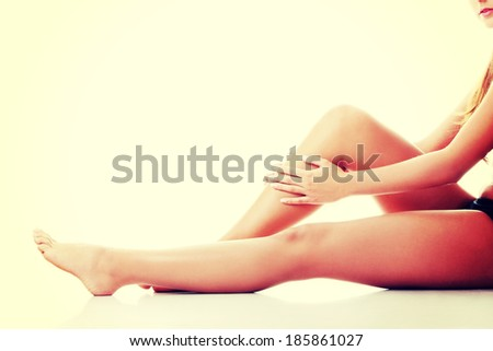 Woman holding on leg