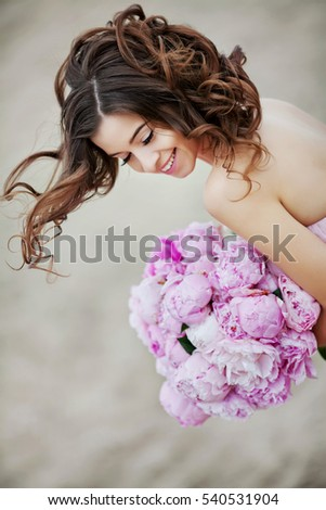 woman holding peony bouquet