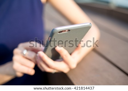 Woman holding phone in her hands